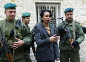 Secretary of State Condoleezza Rice poses next to Palestinian security guards outside the Muqataa headquarters in the West Bank city of Ramallah...