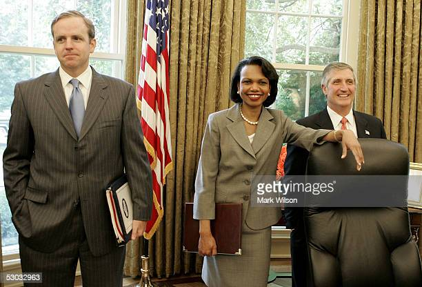 S Secretary of State Condoleezza Rice smiles while standing with White House Chief of Staff Andrew Card and White House Communications Director Dan...