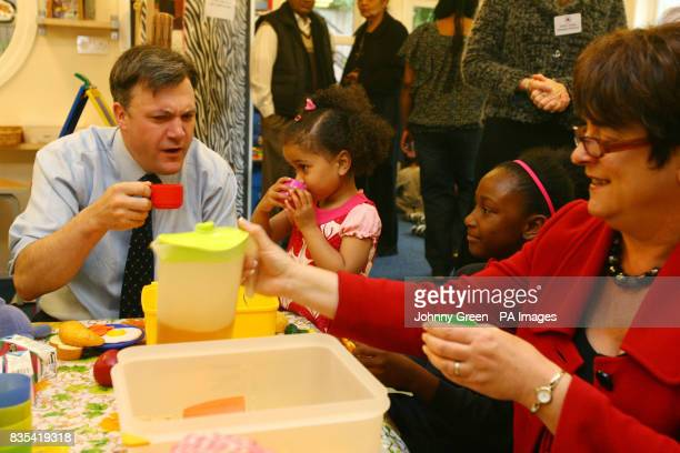 Secretary of State for Children Schools and Families Ed Balls and Schools Minister Sarah McCarty Fry have breakfast with Takara Garnett and Adeola...