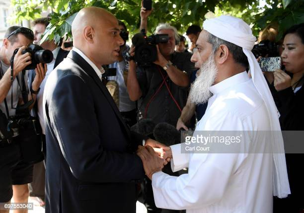 Secretary of State for Communities and Local Government Sajid Javid speaks to an Imam at the scene of a terror attack in Finsbury Park in the early...