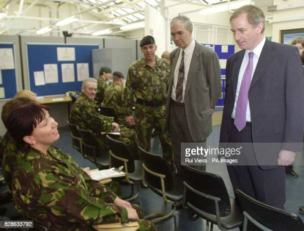 Secretary of State for Defence Geoff Hoon talks to Captain Lindon Davies from Nuneaton during a visit to Chetwyn Army Barracks in Nottingham as part...