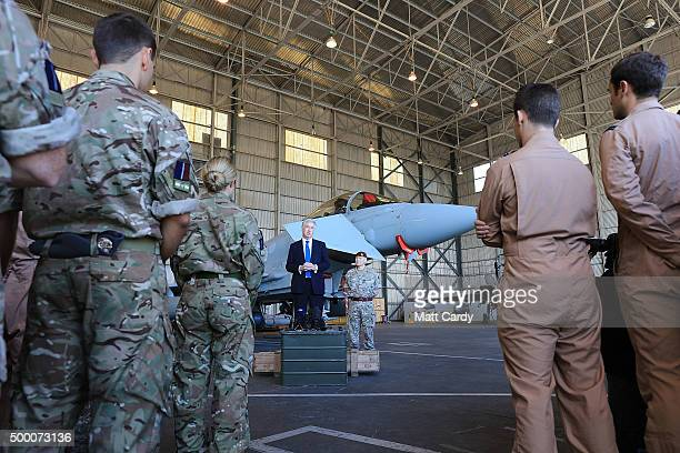 Secretary of State for Defence Michael Fallon accompanied Lieutenant General John Lorimer arrive in a engineering hanger to address Operation SHADER...