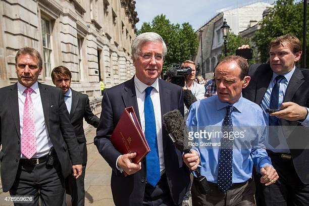 Secretary of State for Defence Michael Fallon leaves the Cabinet Office on Whitehall on June 29 2015 in London England Prime Minister David Cameron...
