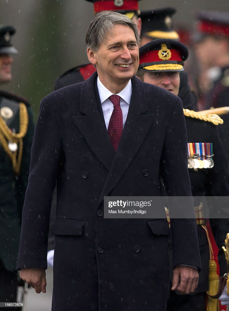 Secretary of State for Defence Philip Hammond inspects the Officer Cadets as he represents Queen Elizabeth II during the Sovereign's Parade at the Royal Military Academy Sandhurst on December 14, 2012 in Sandhurst, England. The parade marks the completion of 44 weeks of training for 200 young people who will be commissioned into the British Army and the armies of 13 overseas countries. Senior Under Officer Sarah Hunter-Choat became the fourth woman in the Royal Military Academy's history to receive the prestigious Sword of Honour which is awarded to the best Officer Cadet on the course.