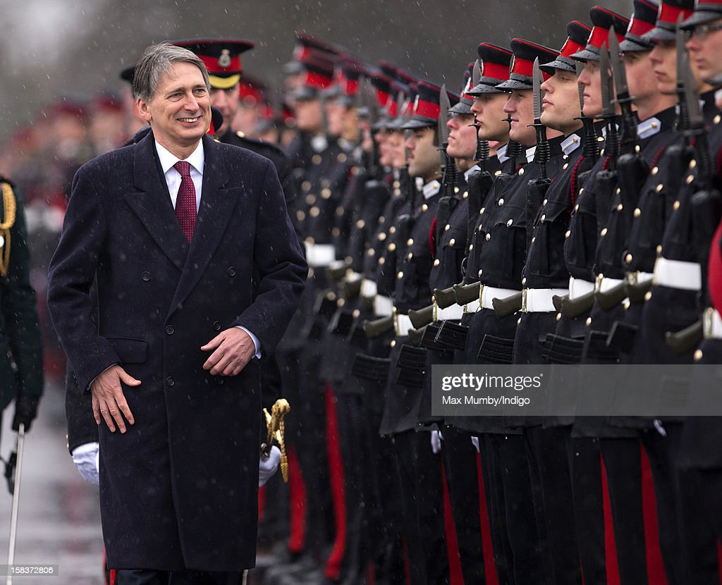 Secretary of State for Defence <a gi-track='captionPersonalityLinkClicked' href=/galleries/search?phrase=Philip+Hammond&family=editorial&specificpeople=2486715 ng-click='$event.stopPropagation()'>Philip Hammond</a> inspects the Officer Cadets as he represents Queen Elizabeth II during the Sovereign's Parade at the Royal Military Academy Sandhurst on December 14, 2012 in Sandhurst, England. The parade marks the completion of 44 weeks of training for 200 young people who will be commissioned into the British Army and the armies of 13 overseas countries. Senior Under Officer Sarah Hunter-Choat became the fourth woman in the Royal Military Academy's history to receive the prestigious Sword of Honour which is awarded to the best Officer Cadet on the course.