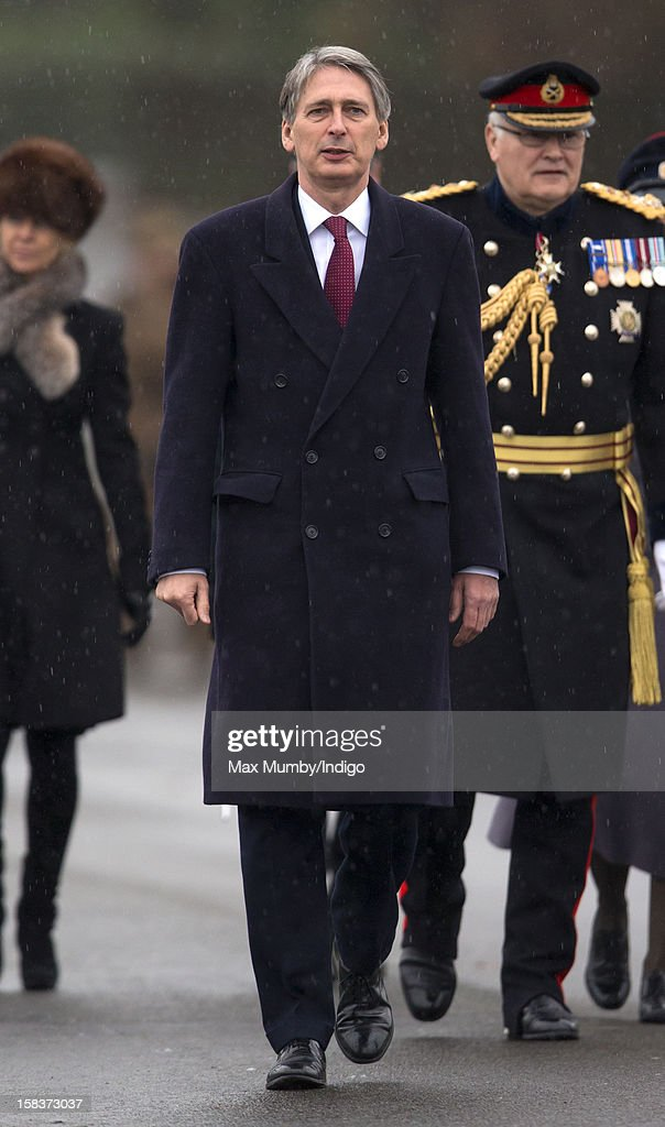 Secretary of State for Defence Philip Hammond represents Queen Elizabeth II during the Sovereign's Parade at the Royal Military Academy Sandhurst on December 14, 2012 in Sandhurst, England. The parade marks the completion of 44 weeks of training for 200 young people who will be commissioned into the British Army and the armies of 13 overseas countries. Senior Under Officer Sarah Hunter-Choat became the fourth woman in the Royal Military Academy's history to receive the prestigious Sword of Honour which is awarded to the best Officer Cadet on the course.