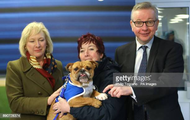 Secretary of State for Environment Michael Gove with Chief Executive Claire Horton and Head of K9 behaviour Ali Taylor holding Enid the Bulldog...