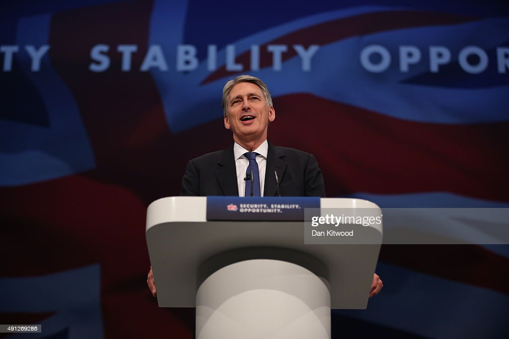 Secretary of State for Foreign and Commonwealth Affairs <a gi-track='captionPersonalityLinkClicked' href=/galleries/search?phrase=Philip+Hammond&family=editorial&specificpeople=2486715 ng-click='$event.stopPropagation()'>Philip Hammond</a> speaks during day one of the Conservative Party Conference on October 4, 2015 in Manchester, England. Up to 80,000 people are expected to attend a demonstration today organised by the TUC and anti-austerity protesters. Conservative Party members are gathering for their first conference as a party in a majority government since 1996.