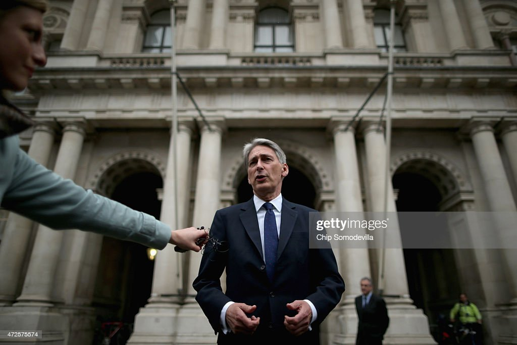 Secretary of State for Foreign and Commonwealth Affairs Philip Hammond makes brief remarks to the press after he arrives at the Foreign and Commonwealth Affairs office May 8, 2015 in London, United Kingdom. Hammond was reappointed Foreign Secretary after the Conservative party, led by Prime Minister David Cameron, won a majority of seats in Parliament in yesterday's general election.