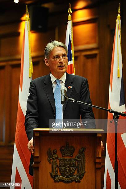 Secretary of State for Foreign and Commonwealth Affairs Philip Hammond speaks prior to presenting a plaque to the Speaker of the New Zealand...