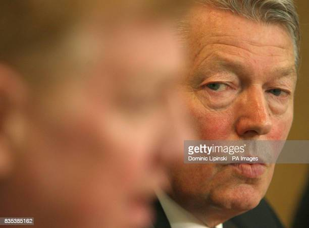 Secretary of State for Health Alan Johnson watches as Chief Medical Officer Liam Donaldson speak at a press conference at the Department of Health...