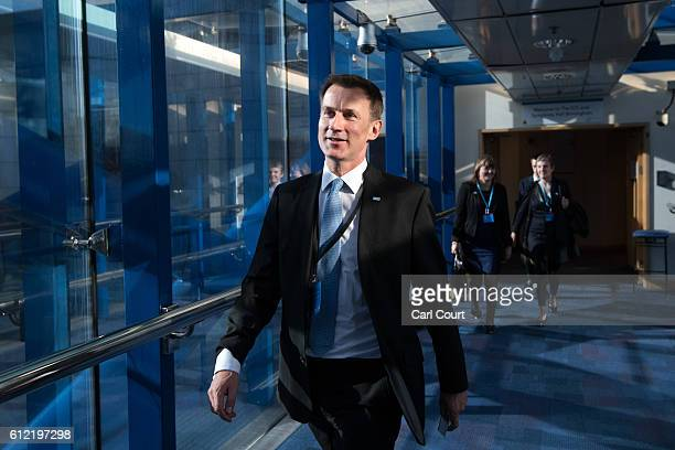 Secretary of State for Health Jeremy Hunt walks to his hotel from the conference centre on the second day of the Conservative Party Conference 2016...