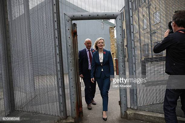 Secretary Of State For Justice Liz Truss is escorted around HMP Brixton by the Prison Govenor David Bamford on November 1 2016 in London England Liz...