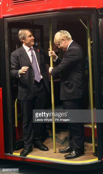 Secretary of State for Northern Ireland Owen Paterson watches on as London Mayor Boris Johnson accidently breaks a pole during the unveiling a...