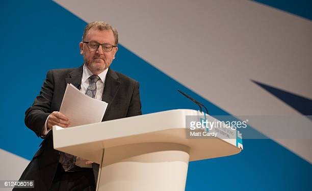 Secretary of State for Scotland David Mundell speaks on stage on the third day of the Conservative Party Conference 2016 at the ICC Birmingham on...