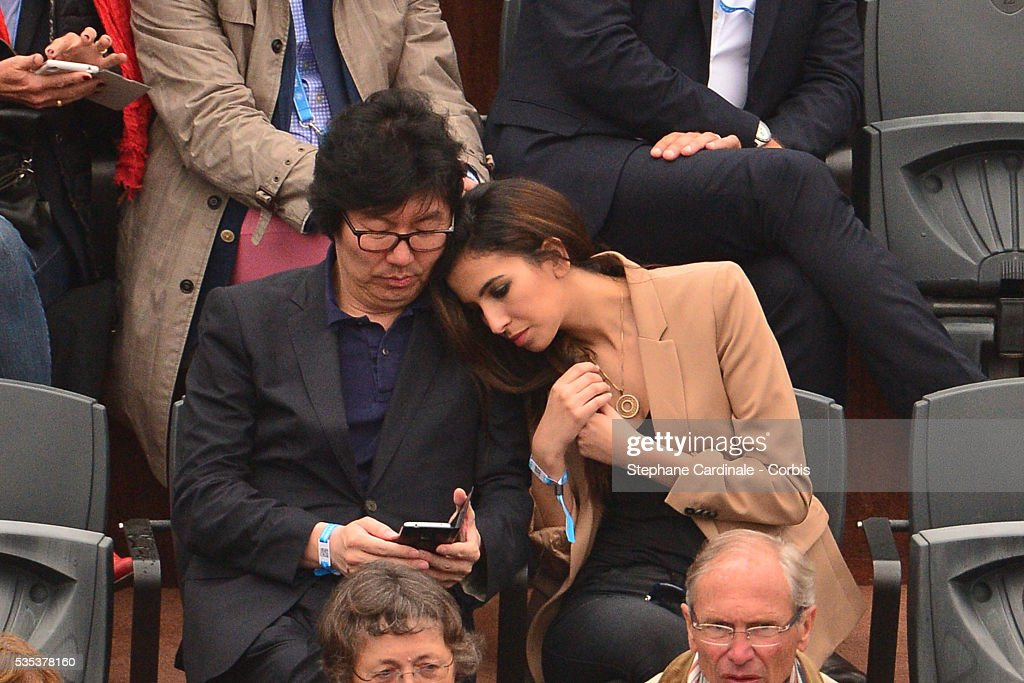 Secretary of State for State Reform Jean-Vincent Place and guest attend day eight of the 2016 French Open at Roland Garros on May 29, 2016 in Paris, France.