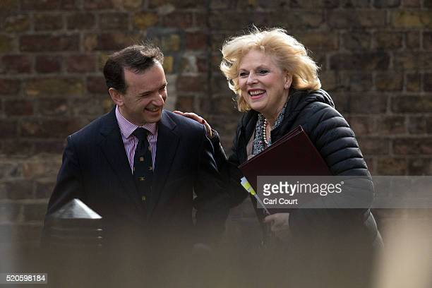 Secretary of State for Wales Alun Cairns laughs with Anna Soubry the Minister for Small Business Industry and Enterprise as they arrive for a cabinet...