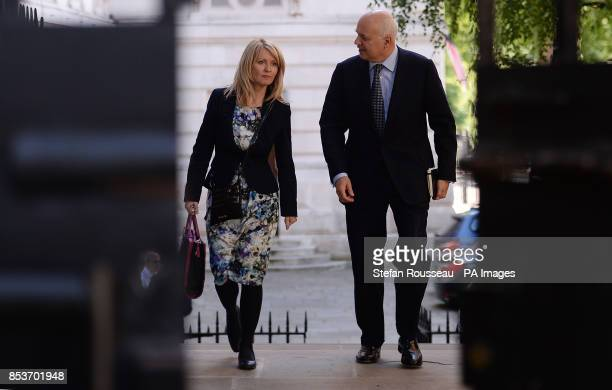 Secretary of State for Work and Pensions Iain Duncan Smith and Employment Minister Esther McVey arrive at 10 Downing Street in London as David...