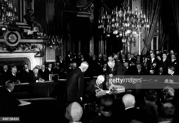 US Secretary of State Frank B Kellogg signs The Kellogg Briand Pact for Renunciation of War as an Instrument of National Policy on August 27 1928 at...