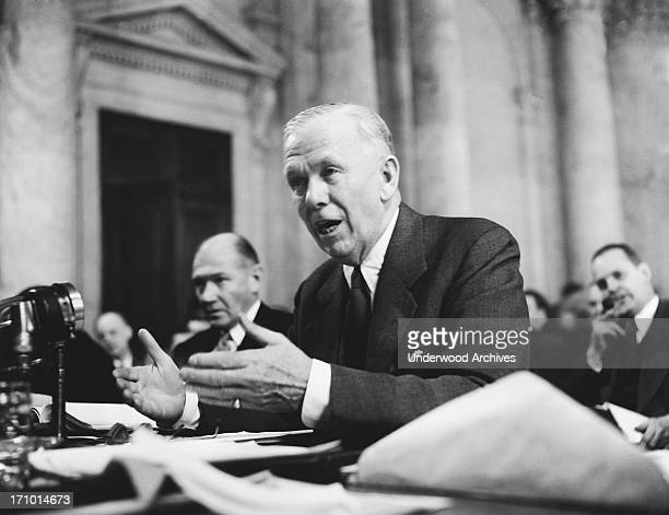 Secretary of State George circa Marshall as he testifies before the Senate Foreign Relations Committee asking them to approve the entire European...