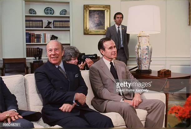 Secretary of State George P Shultz and Vice President George HW Bush at an event in the Oval Office circa 1983 in Washington DC