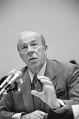 Secretary of State George Shultz testifies at the IranContra hearings before the House Foreign Affairs Committee in December 1986