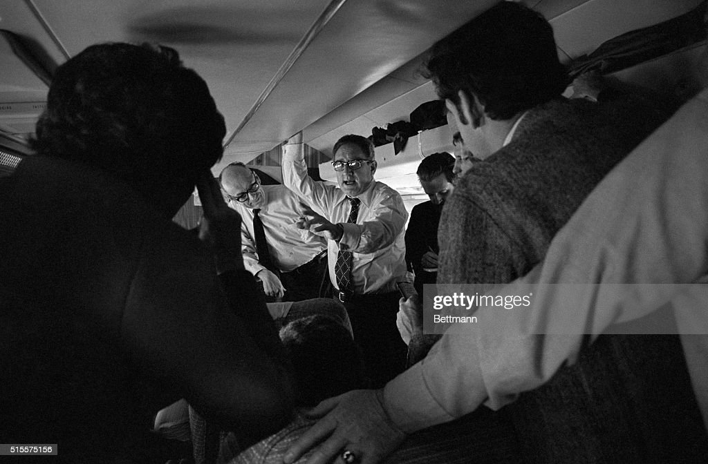 Secretary of State Henry A Kissinger talks with newsmen enroute to Brussels and the opening session of the North Atlantic Treaty Organization Foreign...