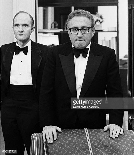Secretary of State Henry Kissinger and his deputy NSC advisor Brent Scowcroft in their White House Office awaiting news that the last Marines in...