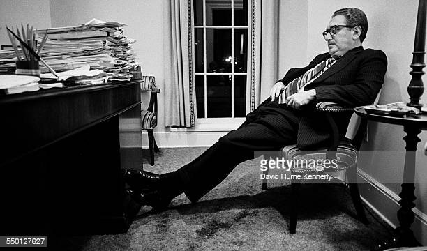 Secretary of State Henry Kissinger in his White House Office reacts to President Gerald R Ford's decision to commence the final evacuation of...