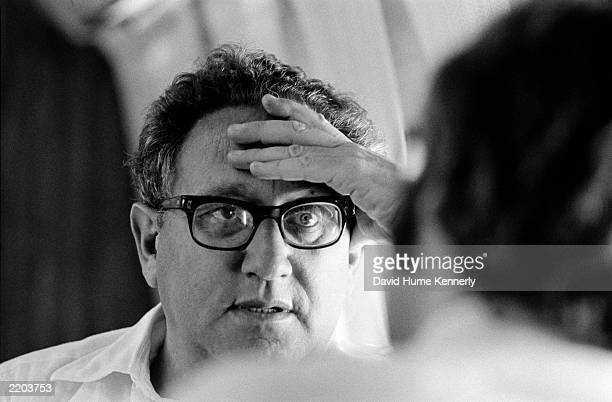 US Secretary of State Henry Kissinger in the cabin of his aircraft as he flew from Alexandria Egypt to Tel Aviv Israel September 27 1975 during...