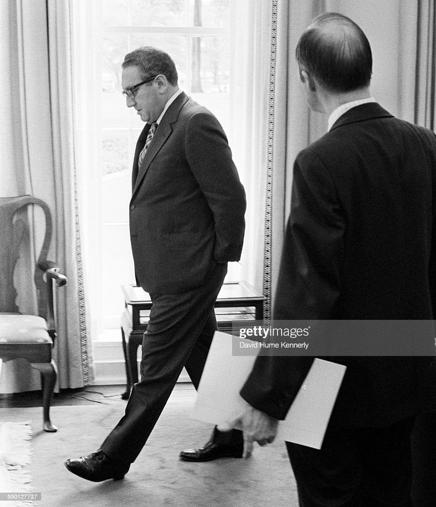 Secretary of State Henry Kissinger paces in his White House office as Deputy National Security Advisor Brent Scowcroft and he discuss why 11 Marines...