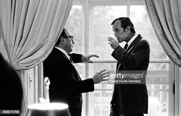 Secretary of State Henry Kissinger talks with George Bush then Chief of the US Liaison Office to the People's Republic of China at the White House on...