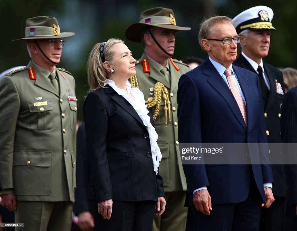 US Secretary of State <a gi-track='captionPersonalityLinkClicked' href=/galleries/search?phrase=Hillary+Clinton&family=editorial&specificpeople=76480 ng-click='$event.stopPropagation()'>Hillary Clinton</a> and Australian Minister for Foreign Affairs <a gi-track='captionPersonalityLinkClicked' href=/galleries/search?phrase=Bob+Carr&family=editorial&specificpeople=209391 ng-click='$event.stopPropagation()'>Bob Carr</a> stand to attention during awreath laying ceremony at Kings Park on November 14, 2012 in Perth, Australia. The bilateral AUSMIN forum will focus on foreign, defence and strategic policy and will be held in Perth today.