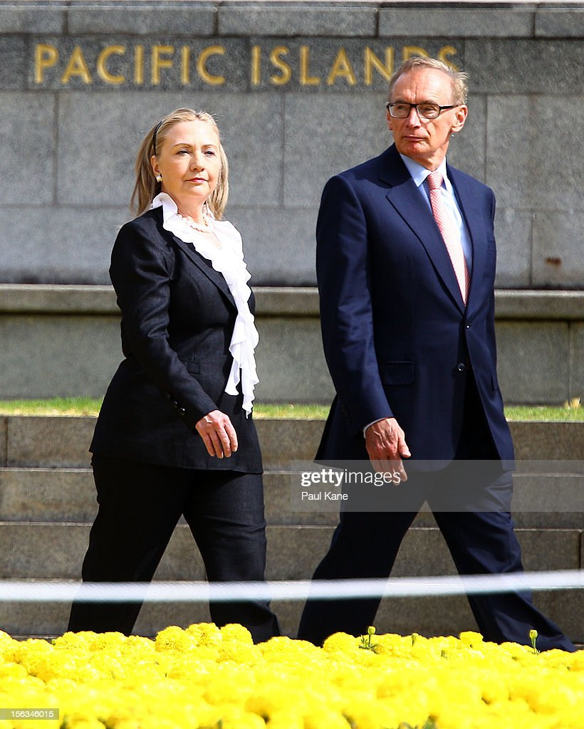 US Secretary of State <a gi-track='captionPersonalityLinkClicked' href=/galleries/search?phrase=Hillary+Clinton&family=editorial&specificpeople=76480 ng-click='$event.stopPropagation()'>Hillary Clinton</a> and Australian Minister for Foreign Affairs <a gi-track='captionPersonalityLinkClicked' href=/galleries/search?phrase=Bob+Carr&family=editorial&specificpeople=209391 ng-click='$event.stopPropagation()'>Bob Carr</a> walk past the Flame of Remembrance at the State War Memorial during a wreath laying ceremony at Kings Park on November 14, 2012 in Perth, Australia. The bilateral AUSMIN forum will focus on foreign, defence and strategic policy and will be held in Perth today.