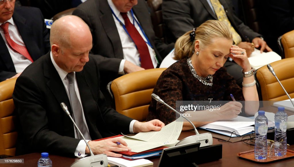 US Secretary of State <a gi-track='captionPersonalityLinkClicked' href=/galleries/search?phrase=Hillary+Clinton&family=editorial&specificpeople=76480 ng-click='$event.stopPropagation()'>Hillary Clinton</a> (R) and British Foreign Secretary William Hague check documents on December 5, 2012 during a meeting with Non-NATO ISAF contributing countries on the second and last day of talks between foreign ministers from the 28 North Atlantic Treaty Organization (NATO) member countries at organization headquarters in Brussels. NATO ministers are to discuss Syria as well as Afghanistan, Russia-NATO ties and the situation in Georgia and the Balkans. AFP PHOTO / POOL / KEVIN LAMARQUE