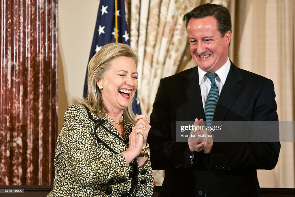 Secretary of State Hillary Clinton (L) and British Prime Minister David Cameron share a laugh during a lunch hosted at the State Department on March 14, 2012 in Washington, DC. Cameron is on an official visit to Washington, where President Obama will host him at a State Dinner tonight.