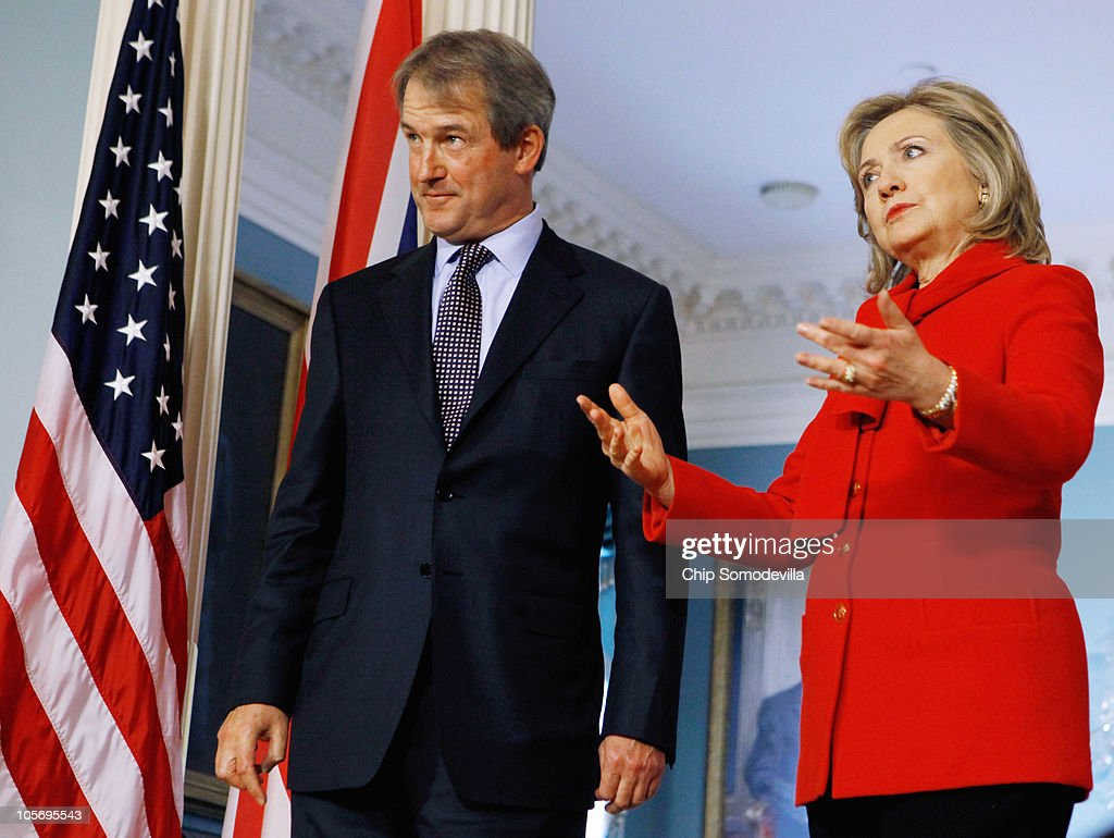 S Secretary of State Hillary Clinton and British Secretary of State for Northern Ireland Owen Paterson talks to reporters at the start of the...