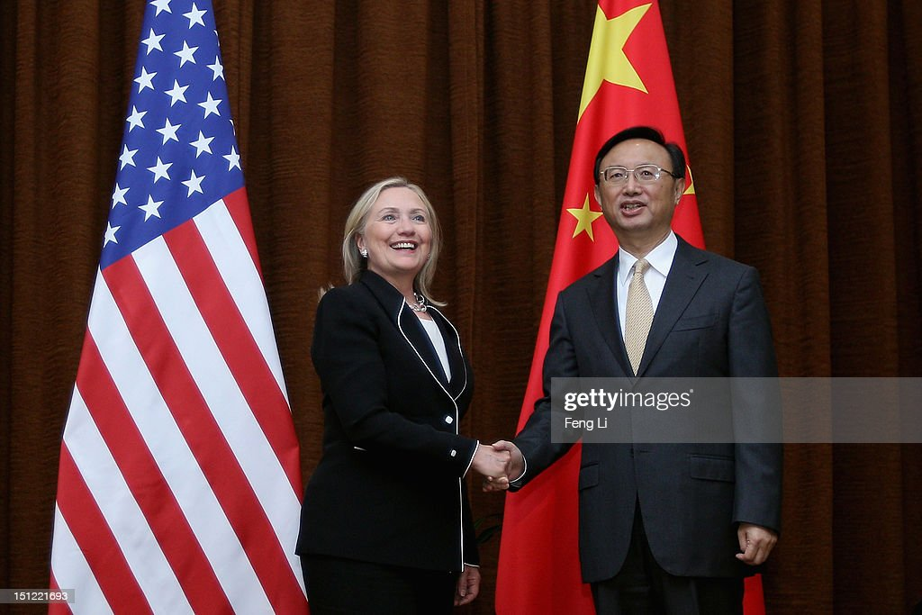 US Secretary of State <a gi-track='captionPersonalityLinkClicked' href=/galleries/search?phrase=Hillary+Clinton&family=editorial&specificpeople=76480 ng-click='$event.stopPropagation()'>Hillary Clinton</a> (L) and Chinese Foreign Minister <a gi-track='captionPersonalityLinkClicked' href=/galleries/search?phrase=Yang+Jiechi&family=editorial&specificpeople=555098 ng-click='$event.stopPropagation()'>Yang Jiechi</a> (R) shake hands during her visit to Beijing on September 4, 2012.