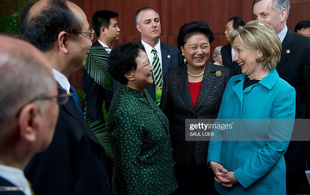 US Secretary of State Hillary Clinton (R) and Chinese State Councilor Liu Yandong (2nd R) greet guests at the National Center for the Performing Arts in Beijing on May 25, 2010. The United States and China were wrapping up strategic talks aimed at smoothing out differences on currency and trade issues, as Washington presses Beijing to get tough on North Korea. AFP PHOTO / POOL / Saul LOEB