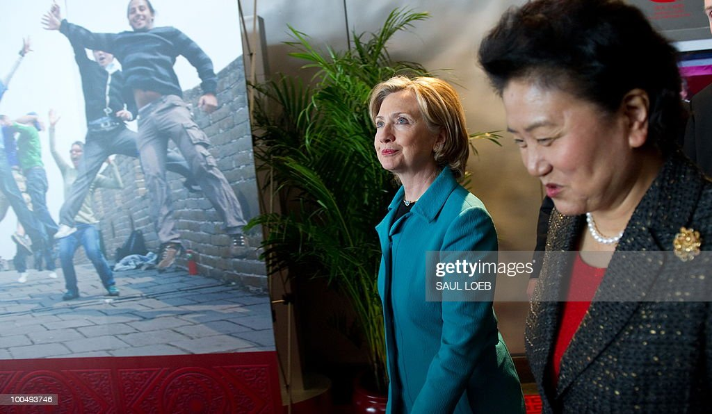 US Secretary of State Hillary Clinton (L) and Chinese State Councilor Liu Yandong (R) walk through the National Center for the Performing Arts after meetings in Beijing on May 25, 2010. The United States and China were wrapping up strategic talks aimed at smoothing out differences on currency and trade issues, as Washington presses Beijing to get tough on North Korea. AFP PHOTO / POOL / Saul LOEB