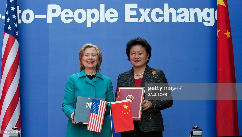 US Secretary of State Hillary Clinton and Chinese State Councilor Liu Yandong (R) stand after signing the US-China Consultation on People-to-People Exchange agreement at the National Center for the Performing Arts in Beijing on May 25, 2010. Clinton arrived in Beijing on May 23 ahead of talks with Chinese leaders on trade issues and security threats including renewed tensions on the Korean peninsula. Clinton flew into the capital from Shanghai, where she had toured the World Expo site, and attended a state dinner hosted by Dai Bingguo, a member of China's State Council, or cabinet. AFP PHOTO / POOL / Saul LOEB