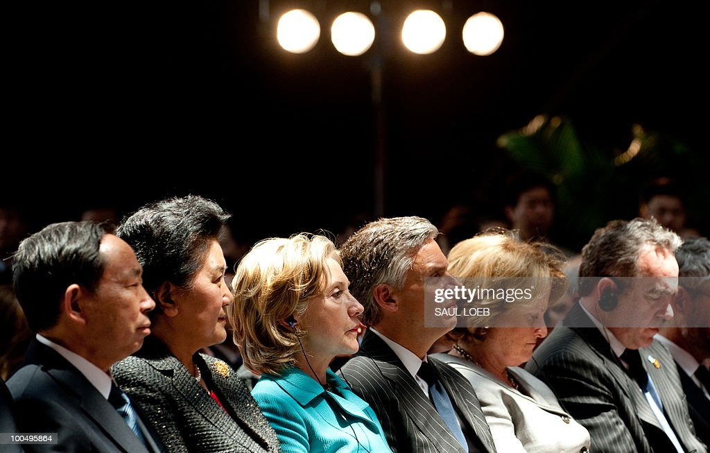 US Secretary of State Hillary Clinton (3rd L) and Chinese State Councilor Liu Yandong (2nd L) watch a presentation before signing the US-China Consultation on People-to-People Exchange agreement at the National Center for the Performing Arts in Beijing on May 25, 2010. Clinton arrived in Beijing on May 23 ahead of talks with Chinese leaders on trade issues and security threats including renewed tensions on the Korean peninsula. Clinton flew into the capital from Shanghai, where she had toured the World Expo site, and attended a state dinner hosted by Dai Bingguo, a member of China's State Council, or cabinet. AFP PHOTO / POOL / Saul LOEB