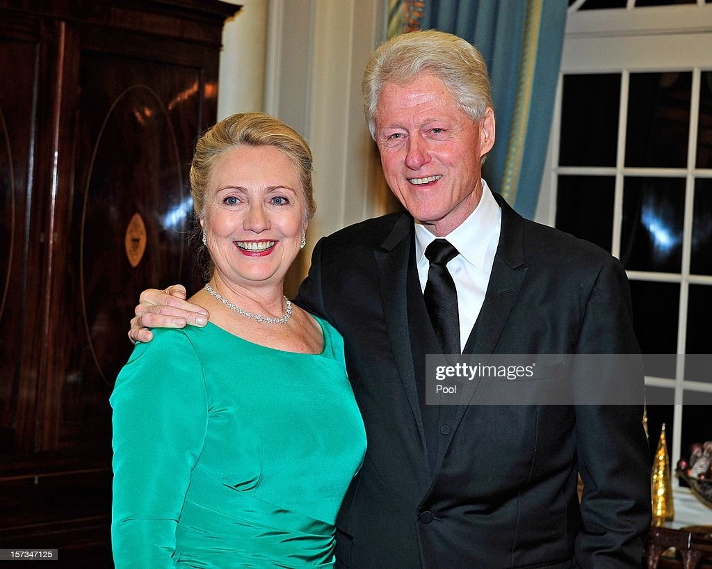 U.S. Secretary of State <a gi-track='captionPersonalityLinkClicked' href=/galleries/search?phrase=Hillary+Clinton&family=editorial&specificpeople=76480 ng-click='$event.stopPropagation()'>Hillary Clinton</a> and former U.S. President <a gi-track='captionPersonalityLinkClicked' href=/galleries/search?phrase=Bill+Clinton&family=editorial&specificpeople=67203 ng-click='$event.stopPropagation()'>Bill Clinton</a> (R) look on following a dinner for Kennedy honorees hosted by U.S. Secretary of State Hillary Rodham Clinton at the U.S. Department of State on December 1, 2012 in Washington, DC. The 2012 honorees are Buddy Guy, actor Dustin Hoffman, late-night host David Letterman, dancer Natalia Makarova, and members of the British rock band Led Zeppelin Robert Plant, Jimmy Page, and John Paul Jones.