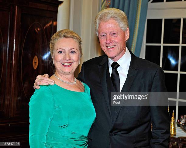 S Secretary of State Hillary Clinton and former US President Bill Clinton look on following a dinner for Kennedy honorees hosted by US Secretary of...