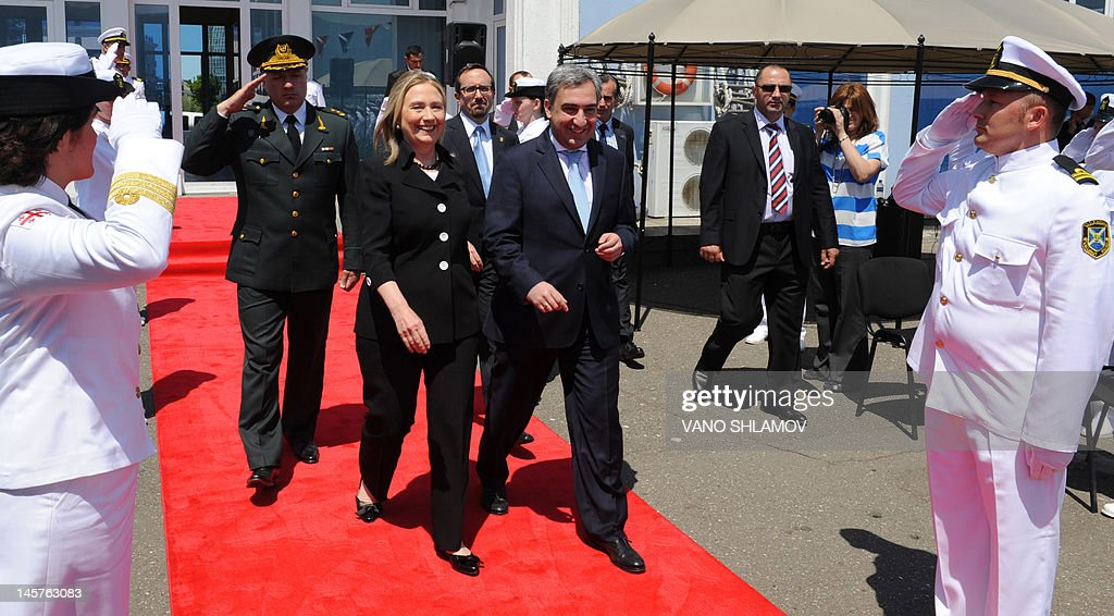 US Secretary of State Hillary Clinton (3rd L) and Georgian Prime Minister Nika Gilauri (3rd R) walk after attending a Coast Guard ship commissioning ceremony at the passenger terminal wharf in the Georgia's Black Sea port of Batumi, on June 5, 2012. The Soviet-designed boat, which will patrol the eastern end of the Black Sea, was commissioned into the Georgian Coast Guard after a refurbishment with the latest technology, using funds provided by the US State Department Export Border Control and Related Security Program.