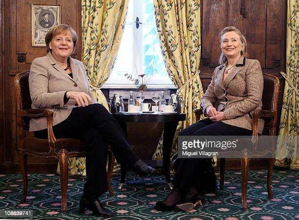 Secretary of State Hillary Clinton and German Chancellor Angela Merkel speak during the second day of the 47th Munich Security Conference at Hotel...