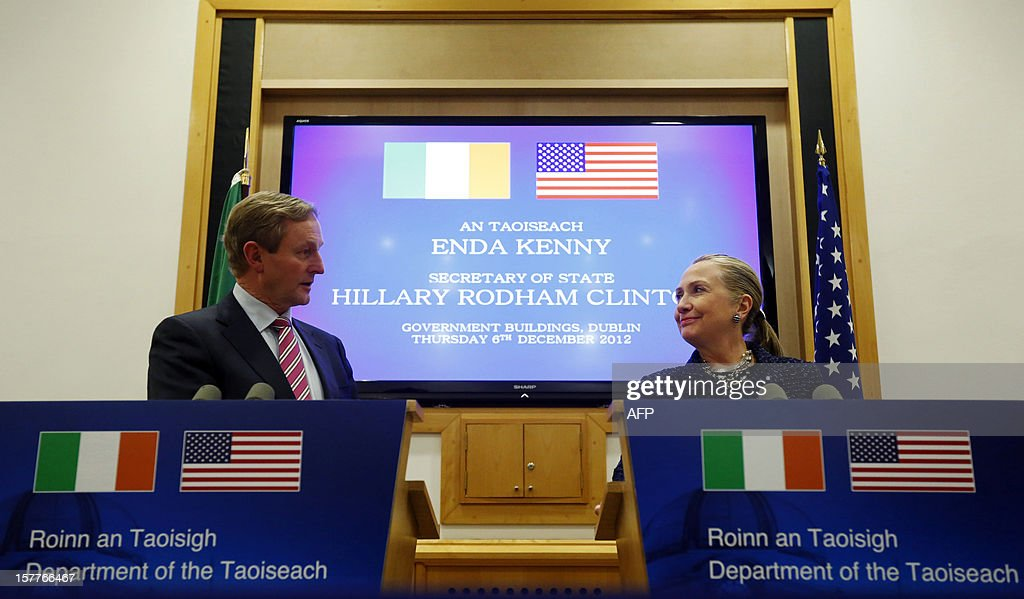 US Secretary of State <a gi-track='captionPersonalityLinkClicked' href=/galleries/search?phrase=Hillary+Clinton&family=editorial&specificpeople=76480 ng-click='$event.stopPropagation()'>Hillary Clinton</a> (R) and Irish Prime Minister Enda Kenny (L) look at each other at the end of a joint press conference in the Government Buildings, Dublin, on December 6, 2012 during her visit for the 19th Ministerial Council of the 57-member Organization for Security and Cooperation in Europe (OSCE). Clinton issued a sharp warning to European and central Asian nations that some countries were backsliding on democratic values and human rights. AFP PHOTO / POOL / KEVIN LAMARQUE