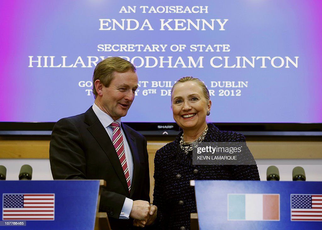 US Secretary of State <a gi-track='captionPersonalityLinkClicked' href=/galleries/search?phrase=Hillary+Clinton&family=editorial&specificpeople=76480 ng-click='$event.stopPropagation()'>Hillary Clinton</a> (R) and Irish Prime Minister Enda Kenny (L) shake hands in Government Buildings, Dublin, on December 6, 2012 during her visit for the 19th Ministerial Council of the 57-member Organization for Security and Cooperation in Europe (OSCE). Clinton issued a sharp warning to European and central Asian nations that some countries were backsliding on democratic values and human rights.