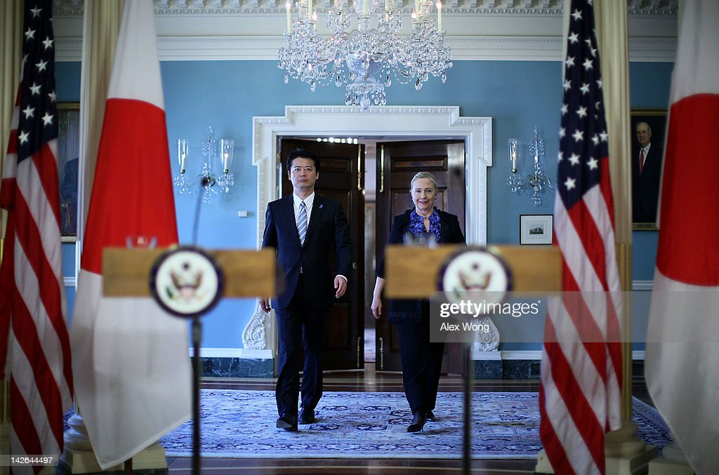 U.S. Secretary of State <a gi-track='captionPersonalityLinkClicked' href=/galleries/search?phrase=Hillary+Clinton&family=editorial&specificpeople=76480 ng-click='$event.stopPropagation()'>Hillary Clinton</a> (R) and Japanese Foreign Minister <a gi-track='captionPersonalityLinkClicked' href=/galleries/search?phrase=Koichiro+Gemba&family=editorial&specificpeople=7046304 ng-click='$event.stopPropagation()'>Koichiro Gemba</a> (L) approach to the podiums for a joint press availability at the State Department April 10, 2012 in Washington, DC. Gemba was in Washington to attend the 2012 G8 Foreign Ministers Meeting.