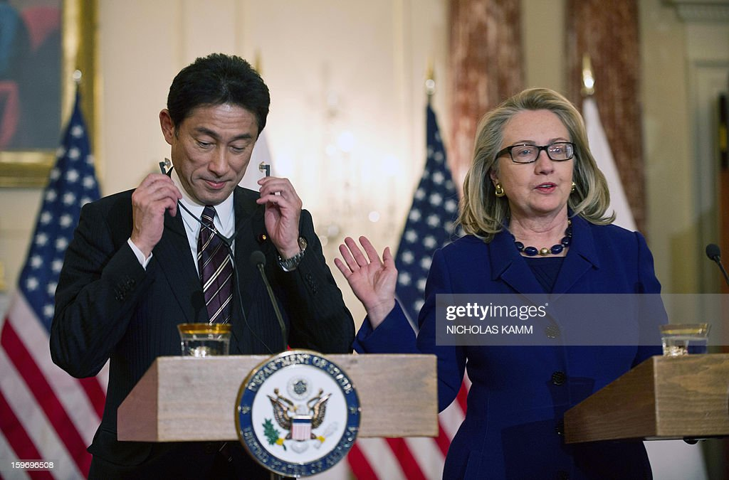 US Secretary of State Hillary Clinton and Japanese Foreign Minister Fumio Kishida arrive to speak to the press following talks at the State Department in Washington on January 18, 2013. AFP PHOTO/Nicholas KAMM